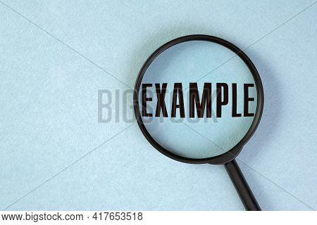 A Concept Image Of A Magnifying Glass On Blue Background With A Word Example Zoom Inside The Glass.
