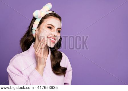 Photo Portrait Of Young Woman Applying Nourishing Face Mask Looking At Empty Space Smiling Isolated