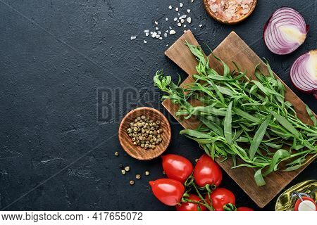 Fresh Tarragon. Branch Of Fresh Herb Seasoning And Cooking Products, Tomatoes, Peppers, Onions And O