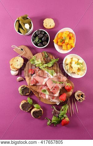 antipasto platter with prosicutto ham,  cheese,  tapenade
