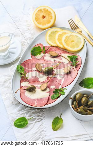Vitello tonnato - Italian cuisine, sliced veal with tuna sauce as antipasto with capers