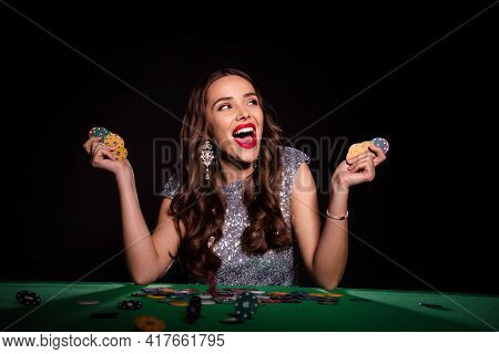 Photo Of Amazed Excited Young Lady Hold Poker Chips Sit Table Luck Winner Rich Money Isolated On Bla