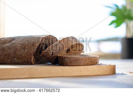 Sliced Bread. Sliced Rye Bread On Cutting Board Closeup