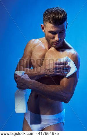 A Man With A Naked Torso Wipes Himself With A Napkin And Holds A Sprayer In His Hand An Inflated Tor