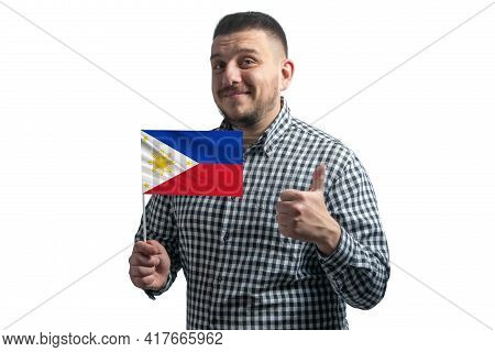 White Guy Holding A Flag Of Philippines And Shows The Class By Hand Isolated On A White Background.