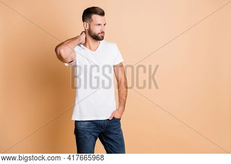Photo Of Young Handsome Man Confident Serious Hand In Pocket Look Empty Space Isolated Over Beige Co