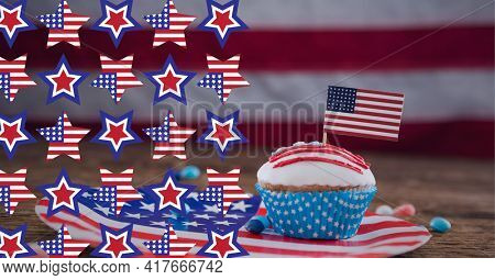 Composition of american flag stars over cupcake over out of focus american flag. american patriotism, democracy and culture concept digitally generated image.
