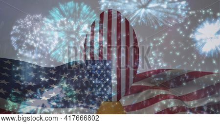 Composition of fireworks with american football over american flag. american patriotism, celebration and sport concept digitally generated video.