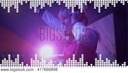 Composition on graphic music equalizer over smiling female dj playing music in club. entertainment, music and clubbing concept digitally generated image.