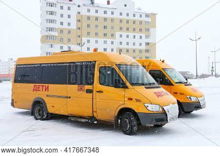 Novyy Urengoy, Russia - March 27, 2021: School Minibuses Mercedes-benz Sprinter In The City Street.