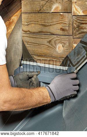 The Worker Mounts A Waterproof Bitumen Membrane With Screws For Waterproofing The Chimney When Insta