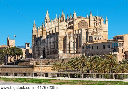 Famous Cathedral of Santa Maria (aka La Seu) under blues sky in Palma de Mallorca, Spain.