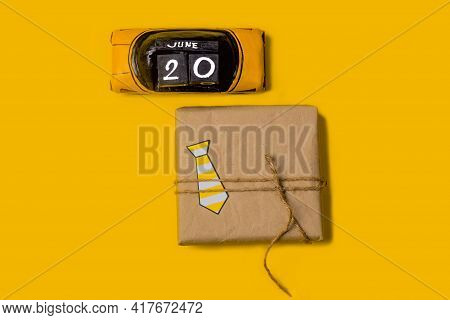 Gift Box On Yellow Background With Father's Day Celebration Date 2021 June 20th. Flat Lay. Father's