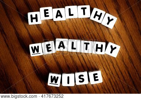 Healthy wealthy and wise words spelled with letters dice as motivation for improving and succeeding