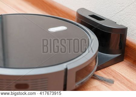 Robot Vacuum Cleaner Go To Charging Dock After It Is Finished. Robotic Vacuum