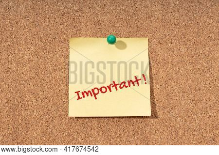 Important Word On Yellow Note On Cork Board