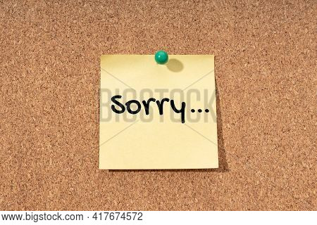 Sorry Word On Yellow Note On Cork Board