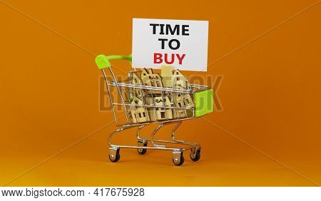 Time To Buy Real Estate Symbol. Miniature Shopping Cart With Wooden Houses, Words Time To Buy. Beaut