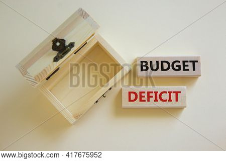 Budget Deficit Symbol. Concept Words 'budget Deficit' On Blocks On A Beautiful White Background, Sma