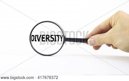 Diversity And Inclusion Symbol. Magnifying Glass With Word Diversity On A Beautiful White Background