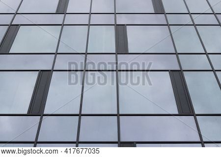View Of A Modern Glass Skyscraper. Glass Skyscraper Close-up