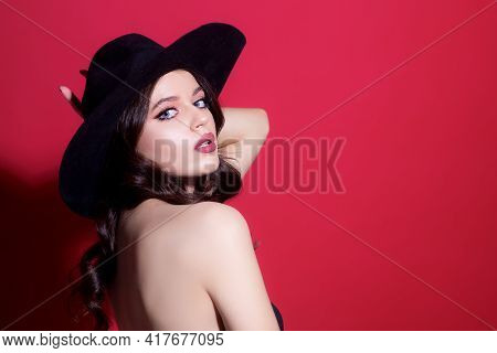 Fashion Model In Black Hat. Elegant Woman. Retro Fashion. Sensual Seductive Fashion Girl.