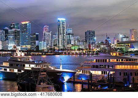 Miami Night Downtown. Miami Florida At Sunset, Skyline Of Illuminated Buildings And Macarthur Causew