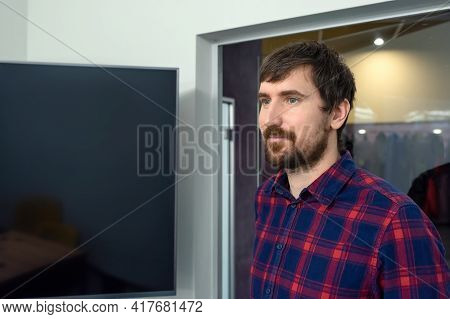 Portrait Of A Young Man Working In The Office. Consulting, Training, Co-working, Business.