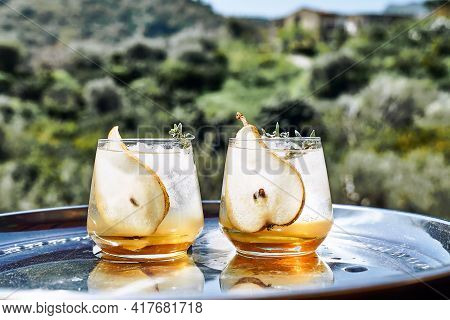 Fresh And Healthy Cocktail Or Mocktail With Pear, Ice And Herbs On The Steel Tray. Refreshing Drink