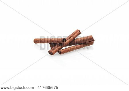 Cinnamon Sticks Isolated On White Background. Close Up View Of The Group Fragrant Cinnamon Sticks.