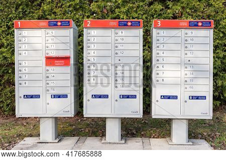 Ottawa, Canada - April 17, 2021: Canada Post Mail Boxes Set In The Neighborhood Community Near Park