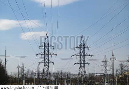 High Voltage Electric Pylon And Electrical Wire With Blue Sky Background. High Voltage Grid Tower Wi
