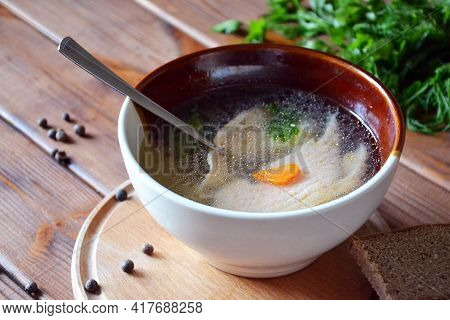 Hot Savory Salmon Soup With Vegetables And Parsley Served In A Clay Bowl, Selective Focus
