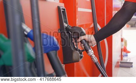 Close Up Of Car Fueling Process At Gasoline Petrol Station, Refuel Petroleum Oil And Energy Vehicle