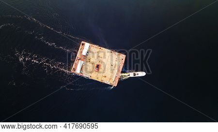 Aerial View Of Small Wooden Ferry Crossing The River With Orange Car On It. Traditional Ferry Boat O