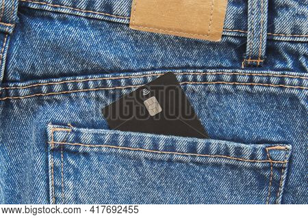 One Credit Plastic Cards With A Chip Black In The Back Pocket Of Blue Jeans