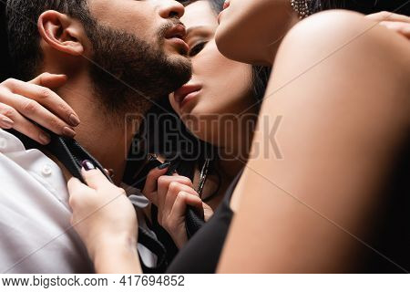 Cropped View Of Passionate Women Seducing Young Man On Blurred Foreground.
