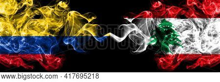 Colombia, Colombian Vs Lebanon, Lebanese Smoky Mystic Flags Placed Side By Side. Thick Colored Silky