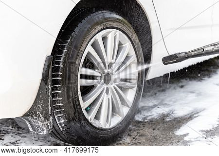Close-up Detail Car Wash With High Pressure Water Equipment Pump At Home Backyard Outdoor On Bright