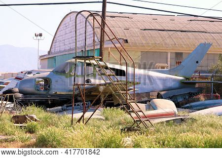 April 15, 2021 In Chino, Ca:  Haunting Image Of Vintage Propeller Planes On A Grassy Field Besides A