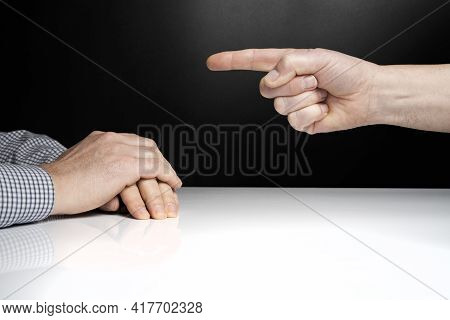 One Man Points His Finger To Another Man In Front