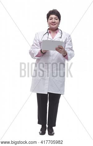 in full growth. female doctor reading a message on a digital tablet.