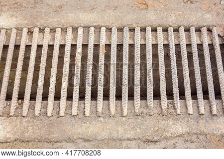 Drainage Channel With A Grate Of Iron Rods Rebar Dirty In A Swamp, Infrastructure Wastewater System