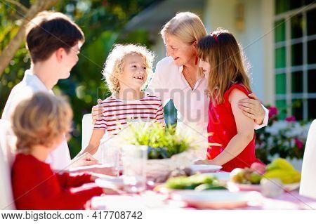 Family Eating Outdoor. Garden Summer Fun.