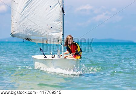 Child Sailing. Kid Learning To Sail On Sea Yacht. Healthy Water Sport For School Kids. Yachting Clas