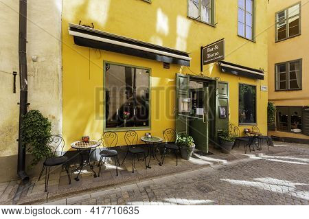 Stockholm, Sweden - July 06, 2017. Bar And Bistro With Open Doors And Tables Outdoors. Sun Reflectio