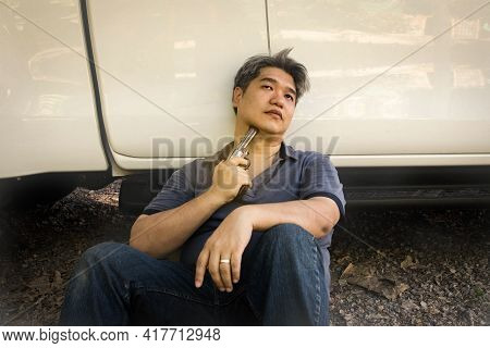 Asian Man Is Depressed With A Lot Of Life Pressures, Stress And Health Problems, Are Contemplating S