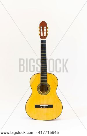 Acoustic Guitar Isolated On White Background Vertical Shoot