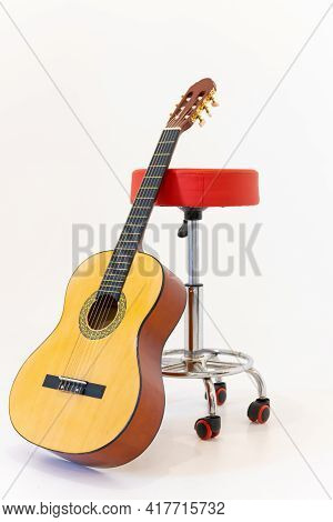 Acoustic Guitar And Chair Isolated On White Background