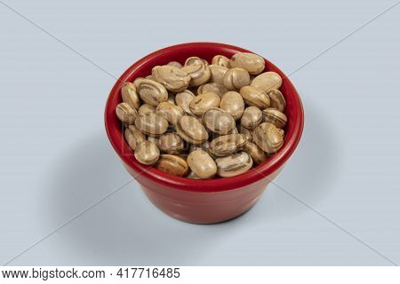 Dry Pinto Bean Seed In Red Plastic Bowl, High Angle Of View
